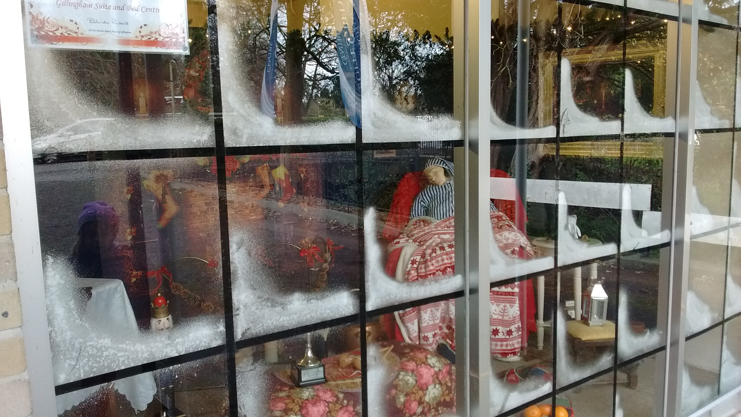 Prizes handed out for gillingham shop window decorations for Store window decorations